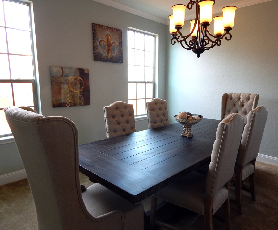 "Client photo: Bramble X-Base dining table with Pierre ""Captain"" chairs and Ava side chairs"