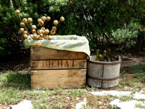 Vintage Champagne Bichat crate with antique wooden well bucket