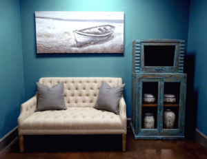 Club loveseat with distressed teak display cabinet