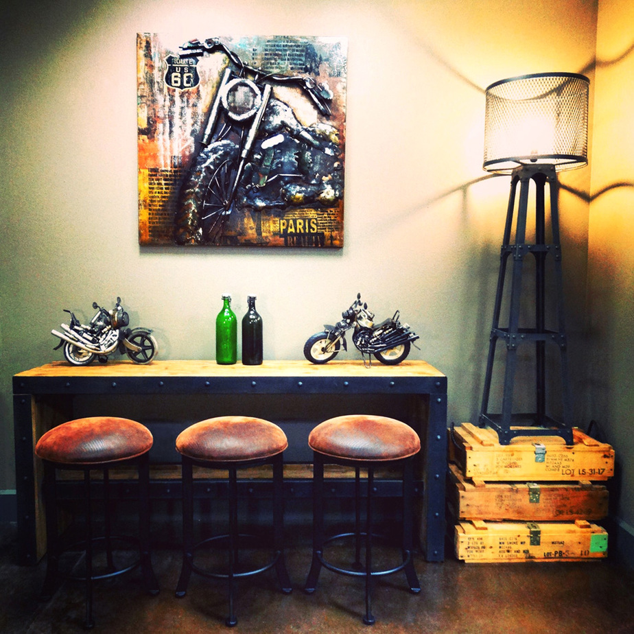 "The ""Moto-Mad Mancave"" with crocodile-print barstools, Spencer floor lamp and vintage ammunition crates"
