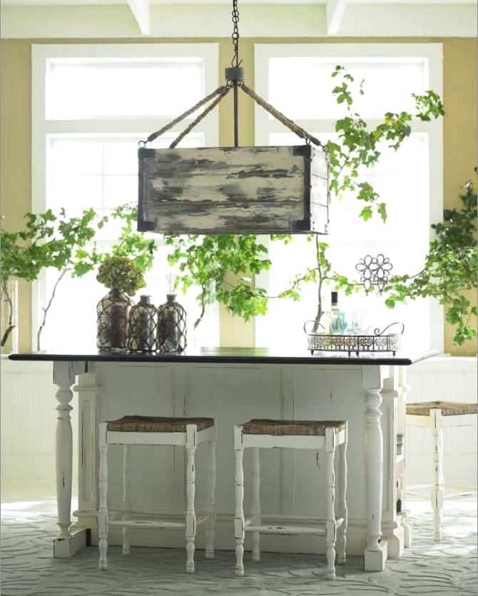 Farmhouse chandelier, Roosevelt breakfast counter and mirrored glass bottles