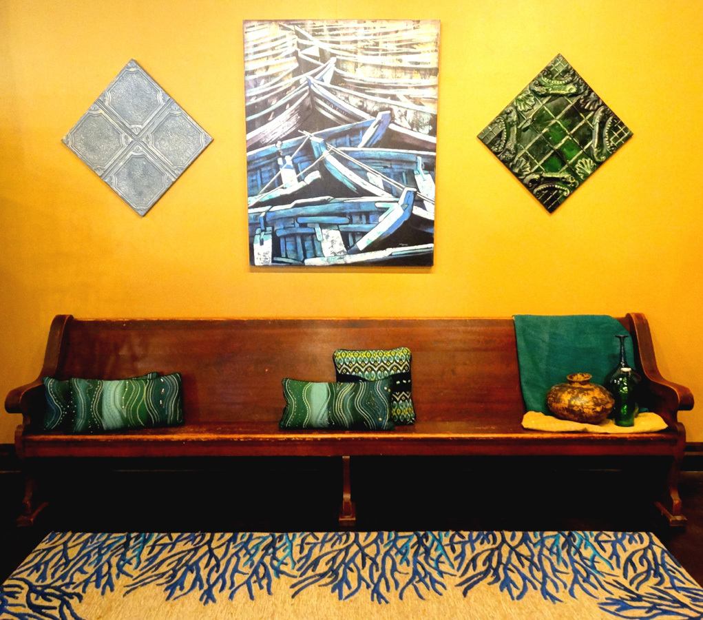 Vintage church pew from East Austin with salvaged New York tin ceiling tiles